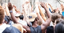 Students holding their hands in the air