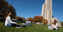 Students studying on Cathedral lawn