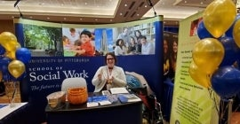 Molly Allwein at CSWE booth