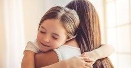 Woman and daughter hugging